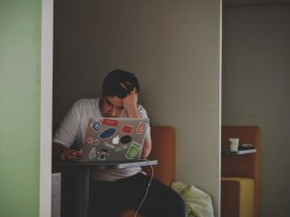 Person stressed out in front of computer